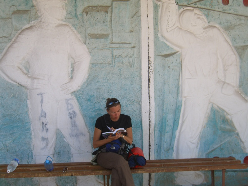 Lonely Planet Reading at Lake Issyk-Kul, Kyrgyzstan