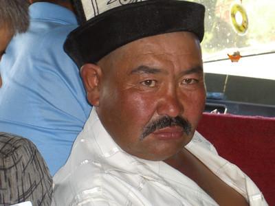Kalpak on the Bus - Karakol, Kyrgyzstan