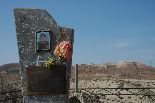 Kyrgyz Cemetery, Medals and Flowers - Manzhyly, Kyrgyzstan