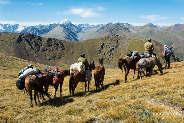 Horsemen Cross the Mountain Pass on Jyrgalan Trek, Kyrgyzstan