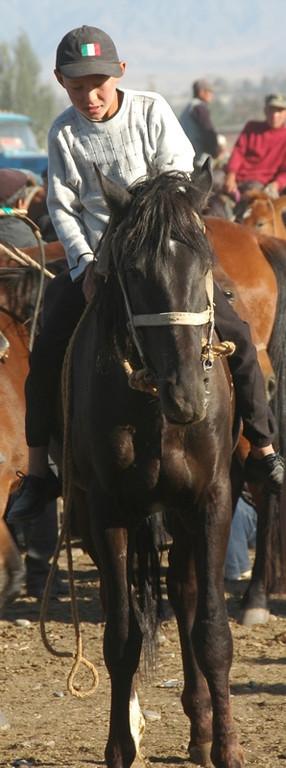 Kyrgyz Boy on Horse - Karakol, Kyrgyzstan