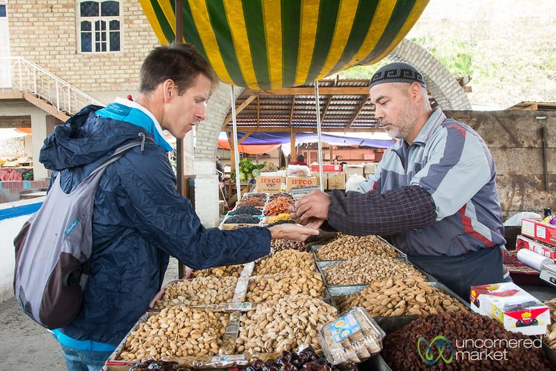 Dan Sampling Nuts at Osh Bazaar - Kyrgyzstan