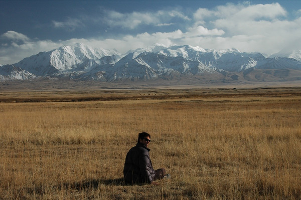 Snow-Covered Mountains, Man in Field - Lenin Peak, Kyrgyzstan
