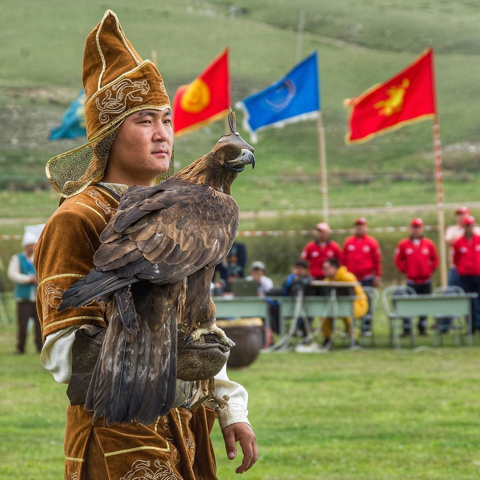 "The World Nomad Games 2016, Kyrgyzstan: Game of Thrones, Genghis Khan, The Olympics and Burning Man all rolled into one. Goat carcass polo, wrestling on horseback, hunting with eagles (one of the competitors, pictured here), stick wrestling, and even the ""intellectual sport"" of sheep knuckle toss. If that's not enough, men ablaze on horseback and an appearance by guest of honor Steven Seagal. If I didn't see it for myself, I would not have believed it. How it all went down is the latest post on our blog (link in profile). via Instagram http://ift.tt/2cTCYr4"