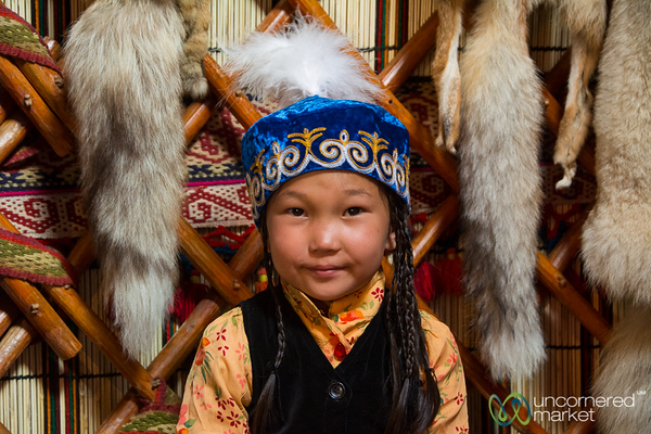 Kyrgyz Girl in Traditional Dress in a Yurt - Kyrchyn Cultural Festival, Kyrgyzstan