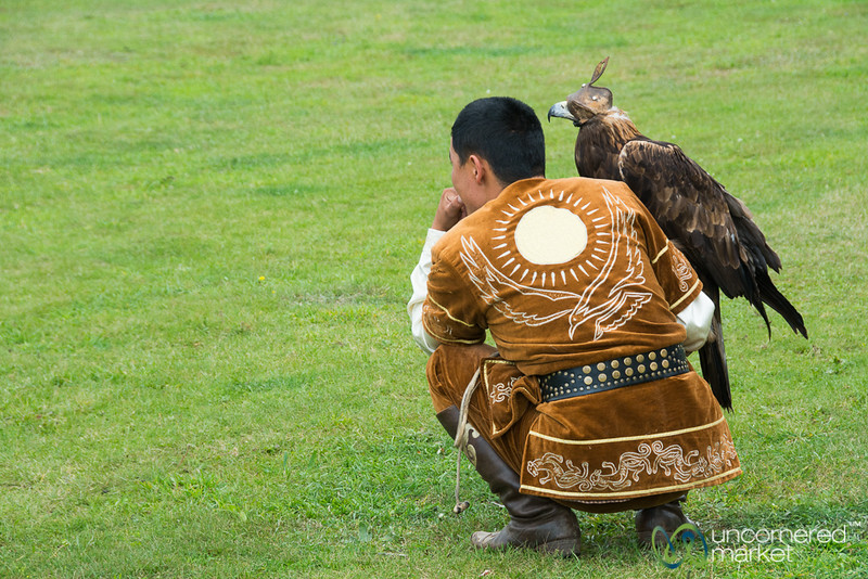 Golden Eagle and his Master at Rest - World Nomad Games, Kyrgyzstan