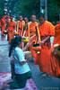 Monks on an alms round.