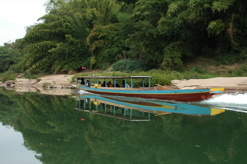 Boat Plying the Waters - Nong Khiaw, Laos