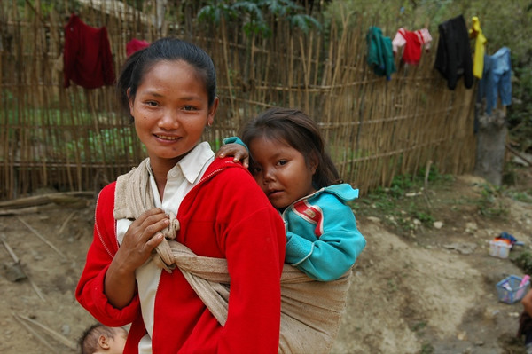 Mother Carrying Child on her Back - Nong Khiaw, Laos