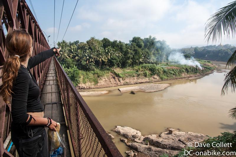 Crossing the bridge in Luang Prabang