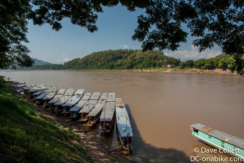Slow boats lined up on the Mekong