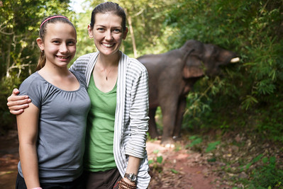 Ana and I watch the elephant enjoy his lunch in Laos.