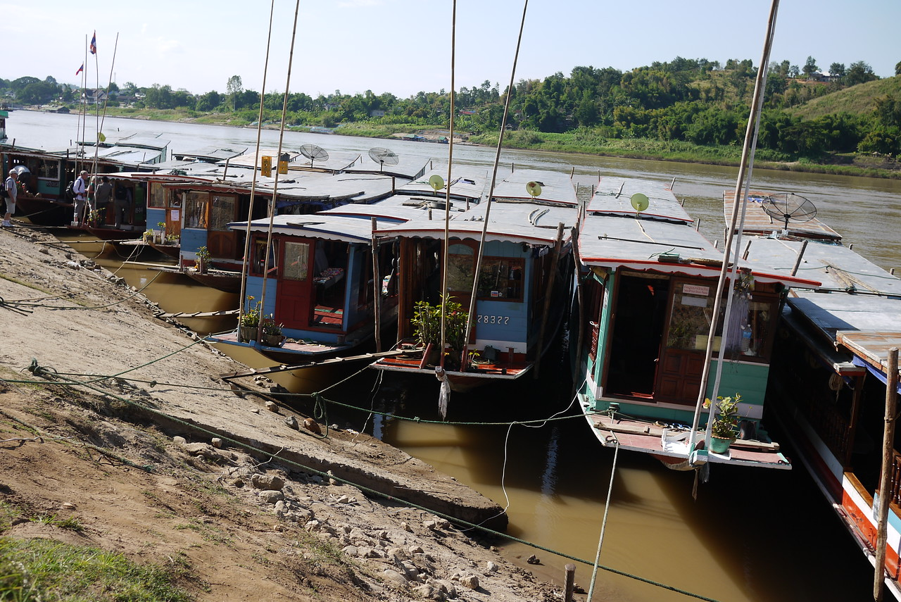 A collection of slow boats waiting to take travelers on the long trip down the Mekong River into Laos.