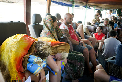 Creative ways to get comfortable on the crowded boat down the Mekong River in Laos.