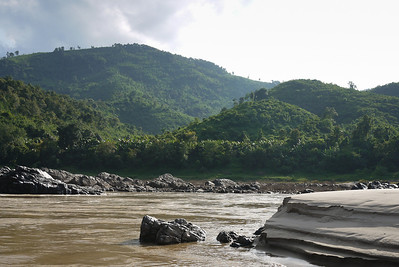 The banks of the Mekong River and surrounding hills on the slow boat down to Pak Beng.