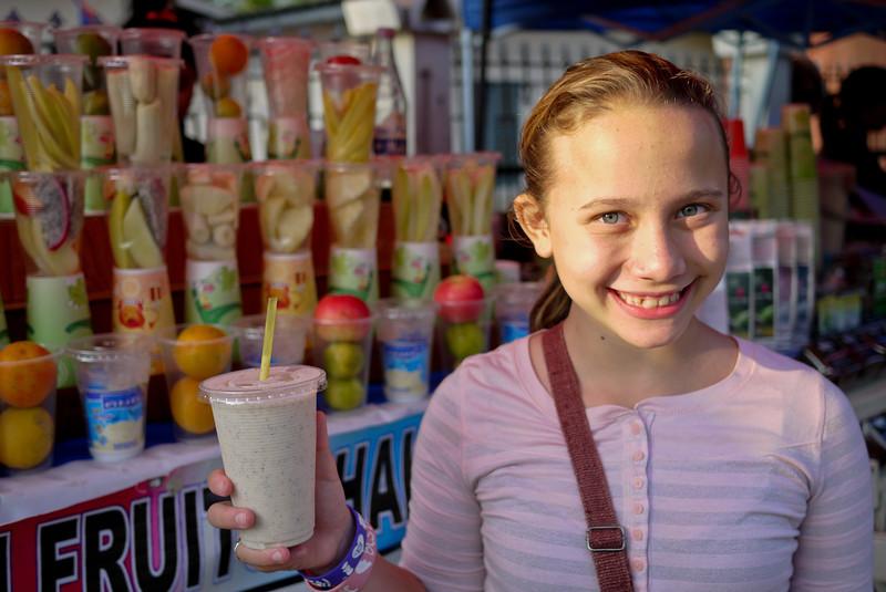 Ana enjoys the street-side fruit shakes in Luang Prabang, Laos.