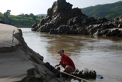 Our boat hit a rock and we had to finangle our way out of a tough spot on the way to Pak Beng, Laos.