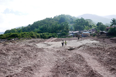 Tha Suang, a small and dusty town on the Mekong River in Laos.