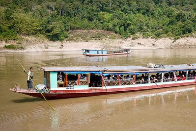 The slow boat pushes off from shore as Ana and I make our way up the huge sand hill to Tha Suang, Laos.