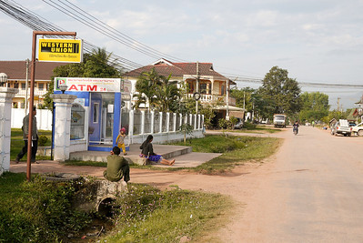 Waiting under the Western Union sign in Laos.
