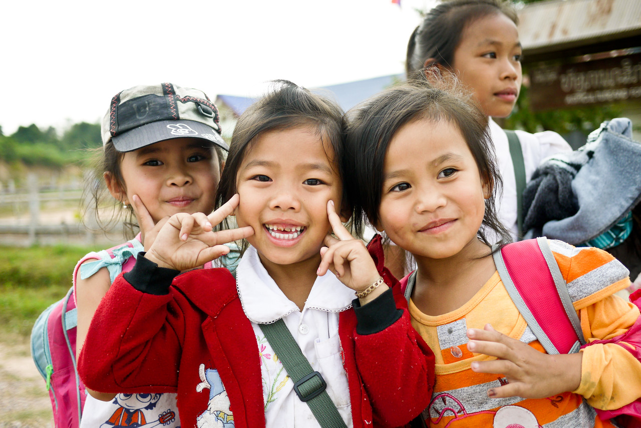 These two cuties are excited to goof off for the camera in rural Laos.