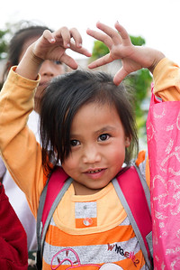 Love from the kids as they make their way home from school in Hongsa, Laos.