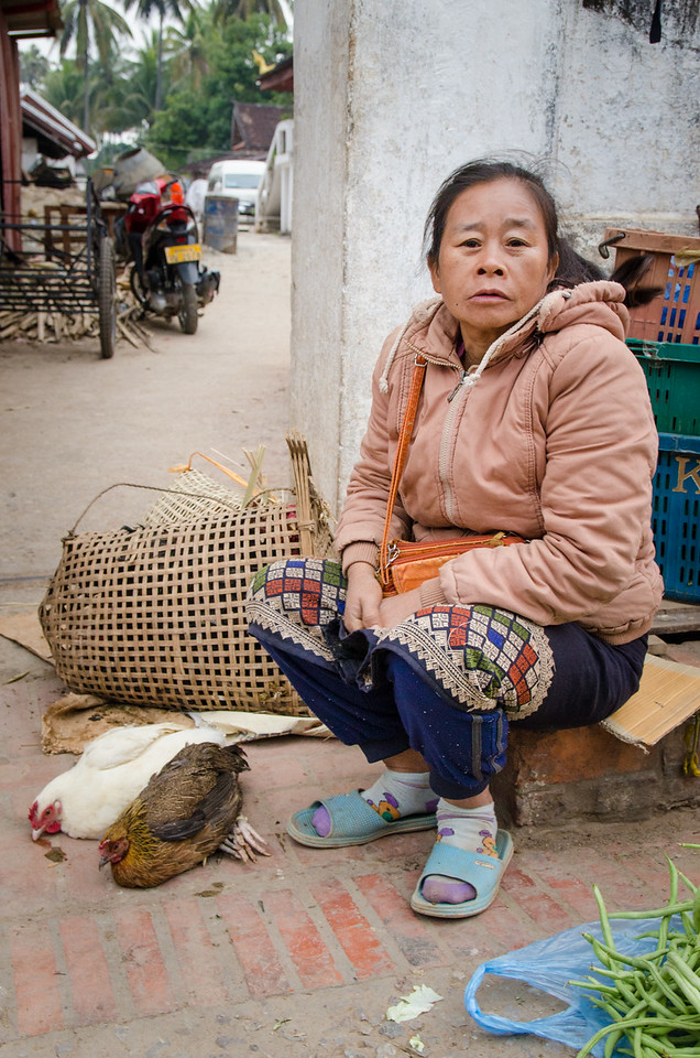 A woman with some chickens to sell.