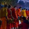 Monks gather for early morning alms giving in Luang Prabang near the morning market.