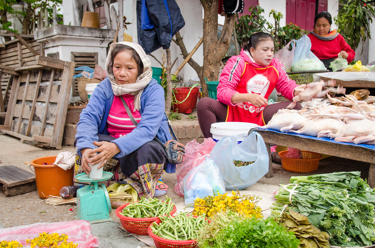 Women selling their goods in the market.