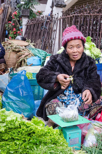 Woman selling veggies.
