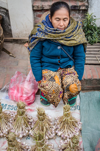 Woman selling garlic.