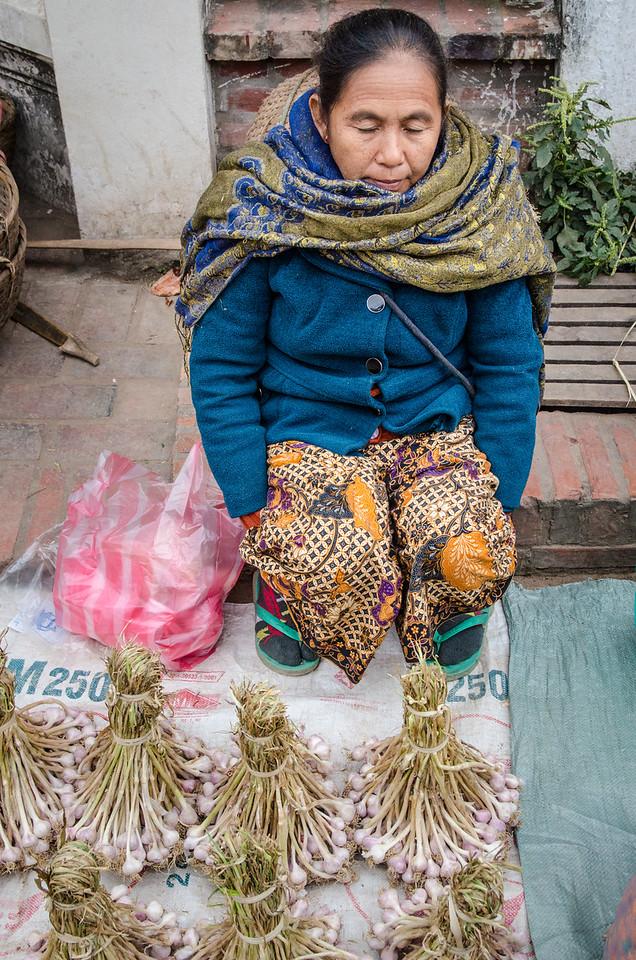 Woman selling garlic.