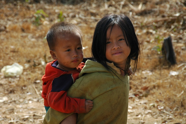 Brother and Sister Piggy-Back Ride - Luang Prabang, Laos