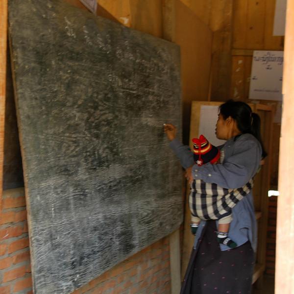 Teacher Carrying Baby - Luang Prabang, Laos