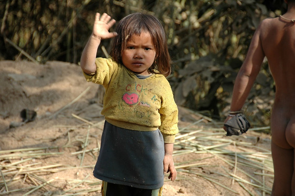 Child Waving Goodbye - Luang Prabang, Laos