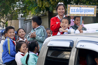 Happy students are randomly parading through the streets in Luang Prabang, Laos