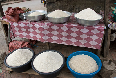 Different varieties of rice on containers at Luang Prang, Laos