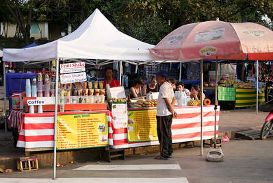 Early morning fruit shake stands set up in Luang Prabang, Laos