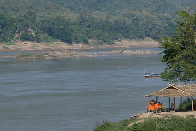 Monks on a hut near the Mekong River in Luang Prang, Laos