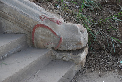 Dragon head carving on end of stairs at Royal Boathouse - Luang Prabang, Laos