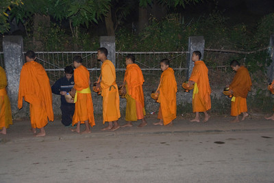 Young monks at Alms ceremony in Luang Prabang, Laos