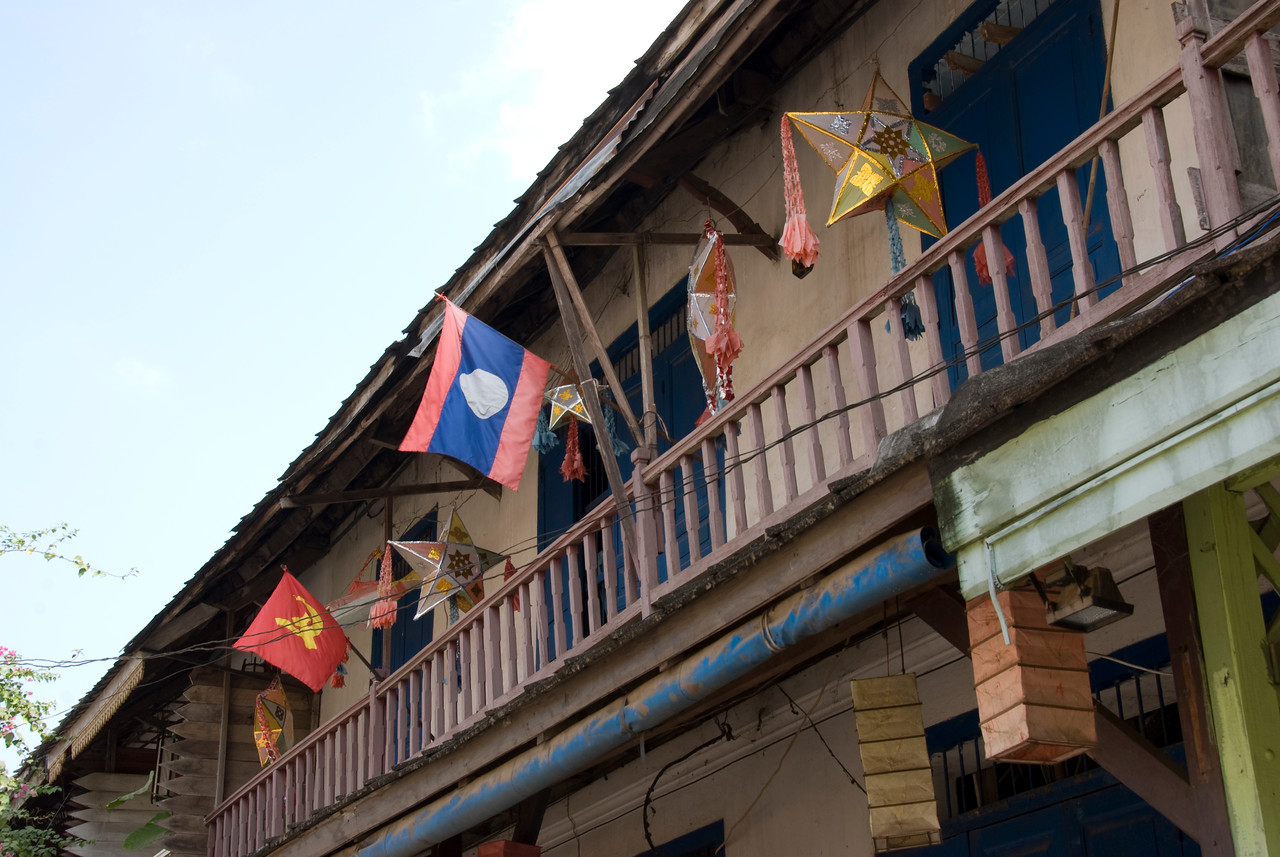 Flags raised on a window at Luang Prang, Laos