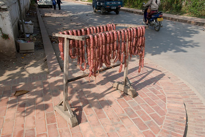 Sausages being dried out on a street in Luang Prabang, Laos