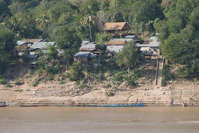 Shot of the houses on village near Mekong River - Luang Prabang, Laos