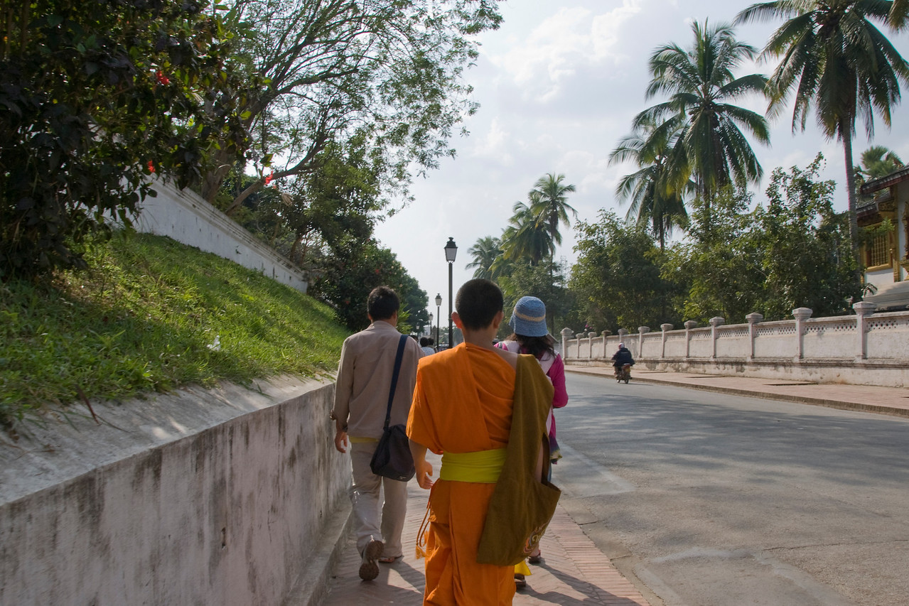 Monk spotted on a sidewalk in Luang Prang, Laos