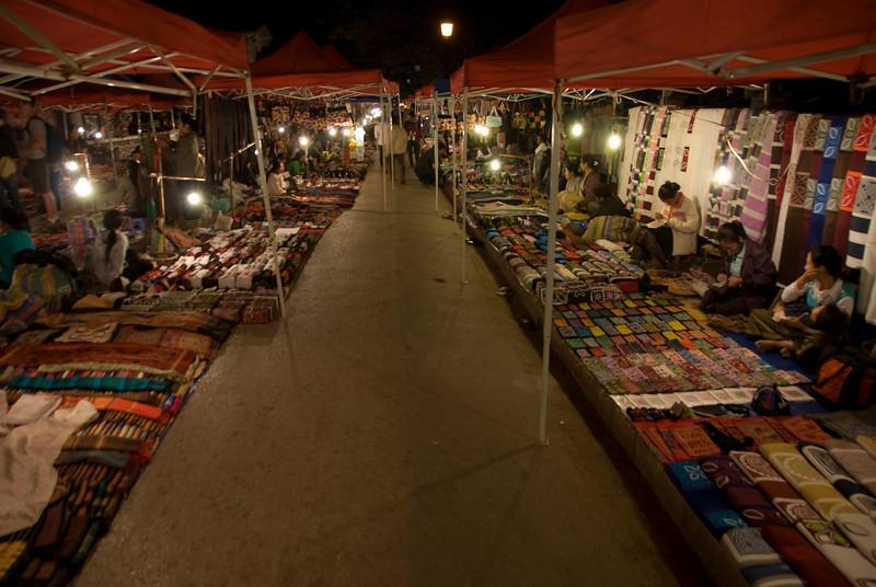 A row of stalls at night market in Luang Prang, Laos