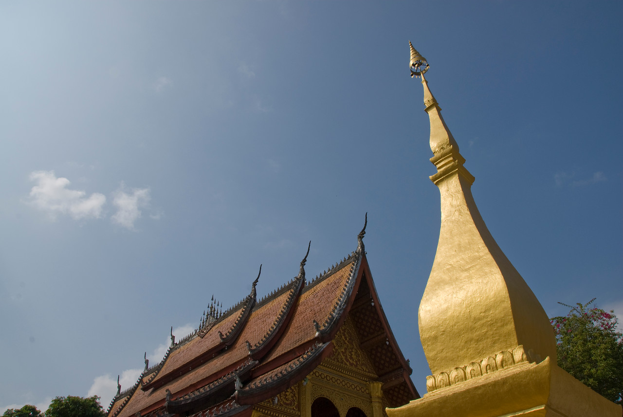 Looking up the temple roof and stupa at Luang Prabang, Laos
