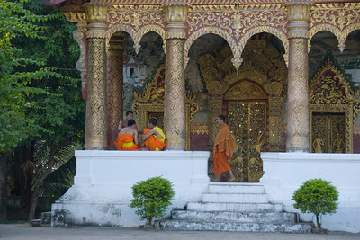 Monks outside the temple in Luang Prang, Laos