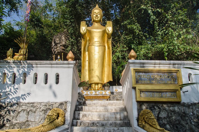 Standing buddha on Mount Phousi.