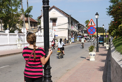 Ana takes in the early morning lazy bustle in Luang Prabang, Laos